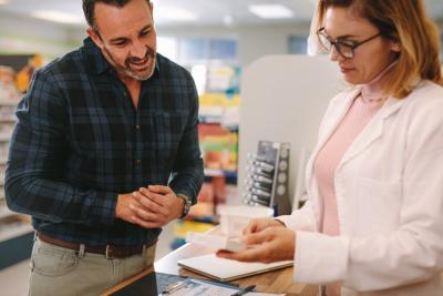 pharmacist entertaining her customer